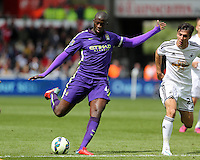 SWANSEA, WALES - MAY 17: Yaya Toure of Manchester City scores his second goal making the score 3-2 to his team during the Premier League match between Swansea City and Manchester City at The Liberty Stadium on May 17, 2015 in Swansea, Wales. (photo by Athena Pictures/Getty Images)