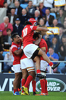 Jack Ram of Tonga is smothered after scoring a try during Match 20 of the Rugby World Cup 2015 between Tonga and Namibia - 29/09/2015 - Sandy Park, Exeter<br /> Mandatory Credit: Rob Munro/Stewart Communications