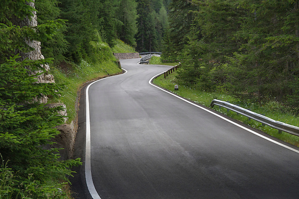 Paved road in the Dolomites near Val Gardena, Italy,