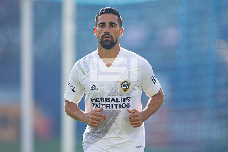 CARSON, CA - MAY 8: Sebastian Lletget #17 of the Los Angeles Galaxy heads to the corner during a game between Los Angeles FC and Los Angeles Galaxy at Dignity Health Sports Park on May 8, 2021 in Carson, California.