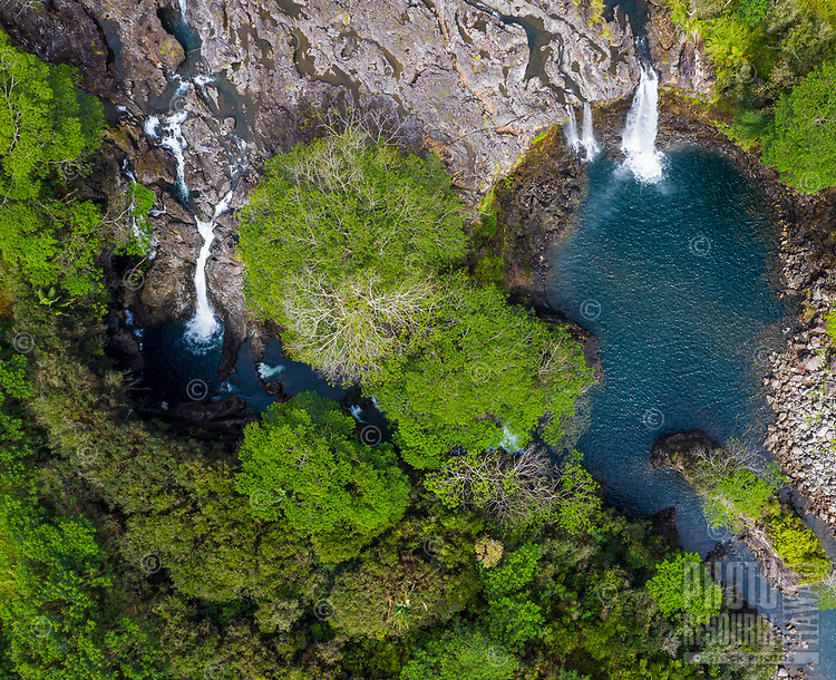 An aerial view of the waterfalls at Boiling Pots, historic pools in the Wailuku River in Hilo, Big Island of Hawai'i.