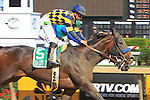 Awesomemundo & Mike Smith run down Love And Pride to win the Allaire Dupont Distaff for fillies and mares, 3-year ols & up going 1 1/16 miles at Pimlico. Trainer Bob Baffert.  Owner Natalie Baffert.