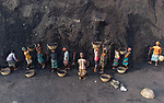 "Pictured: Workers are dwarfed by a mountain of coal as they fill wooden baskets at an open cast coal mine ahead of transportation in Barishal, Bangladesh. <br /> <br /> The photos were taken by photographer Mustasinur Rahman Alvi.<br /> <br /> The workers often transport hundreds of kilograms of coal each day, earning as little as £3.<br /> <br /> 23 year-old Mustasinur Rahman Alvi said ""I like how amidst all of the struggle you can really see the bonding between the labourers to help fill the loaded baskets"".<br /> <br /> Please byline: Mustasinur Rahman Alvi /Solent News<br /> <br /> © Mustasinur Rahman Alvi /Solent News & Photo Agency<br /> UK +44 (0) 2380 458800"