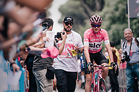 Maglia Rosa / overall leader Chris Froome (GBR/SKY) escorted to the sign-on podium (flanked by his bodyguard)<br /> <br /> stage 21: Roma - Roma (115km)<br /> 101th Giro d'Italia 2018