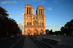 West front of Notre Dame cathedral in evening sunlight. city of Paris. Paris. France