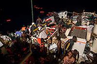 Die Sea Watch-2 Crew war am Freitag den 21. Oktober 2016 in den fruehen Morgenstunden waehrend ihrer 13. SAR-Mission vor der libyschen Kueste zu einer Position ausserhalb der 12 Meilenzone gerufen worden. Es war ein Fluechtlingsschlauchboot gesichtet worden. Als die Sea Watch-2 dort eintraf sah sie ca. 150 Menschen zusammengepfercht in einem ueberfuellten Schlauchboot sitzen. Eine Versorgung der Menschen auf dem Fluechtlingsschlauchboot mit Rettungswesten durch die Rettungs Boote der Sea Watch-2 wurde von der libyschen Kuestenwache unterbunden. Ein Soldat der Kuestenwache enterte das Schlauchboot vom Bug und machte sich dann an dem Aussenbordmotor zu schaffen. Auf dem Weg dahin schlug und trat er die Gefluechteten ein. Nach einigen Minuten entfernte sich das Boot der Kuestenwache. Dann verlor der Bug des Schlauchbootes seine Luft und es brach Panik bei den Gefluechteten aus. Sie sprangen in das Wasser und versuchten zum Schiff Sea Watch-2 zu gelangen. Die Crew warf ihnen Schwimmwesten und Rettungsringe zu, die Besatzungen der Rettungsboote der Sea Watch-2 zogen Menschen aus dem Meer, dennoch sind bis zu 30 Menschen ertrunken. Vier Ertrunkene konnten von der Sea Watch geborgen werden.<br /> Im Bild: Die ersten Menschen die sich an Bord der Sea Watch-2 retten konnten.<br /> 21.10.2016, Mediterranean Sea<br /> Copyright: Christian-Ditsch.de<br /> [Inhaltsveraendernde Manipulation des Fotos nur nach ausdruecklicher Genehmigung des Fotografen. Vereinbarungen ueber Abtretung von Persoenlichkeitsrechten/Model Release der abgebildeten Person/Personen liegen nicht vor. NO MODEL RELEASE! Nur fuer Redaktionelle Zwecke. Don't publish without copyright Christian-Ditsch.de, Veroeffentlichung nur mit Fotografennennung, sowie gegen Honorar, MwSt. und Beleg. Konto: I N G - D i B a, IBAN DE58500105175400192269, BIC INGDDEFFXXX, Kontakt: post@christian-ditsch.de<br /> Bei der Bearbeitung der Dateiinformationen darf die Urheberkennzeichnung in den EXIF- und  IPTC-Daten nicht entfernt w