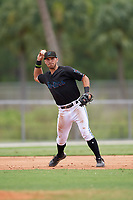GCL Marlins third baseman Zachary Owings (20) throws to first base during a Gulf Coast League game against the GCL Astros on August 8, 2019 at the Roger Dean Chevrolet Stadium Complex in Jupiter, Florida.  GCL Marlins defeated GCL Astros 5-4.  (Mike Janes/Four Seam Images)