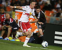 Chris Pontious (13) of D.C. United battles for the ball with Jan Gunnar Solli (8) of the New York Red Bulls during an MLS match at RFK Stadium, in Washington D.C. on April 21 2011. Red Bulls won 4-0.