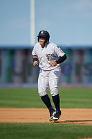 Staten Island Yankees third baseman Andres Chaparro (26) leads off first base during a game against the Lowell Spinners on August 22, 2018 at Richmond County Bank Ballpark in Staten Island, New York.  Staten Island defeated Lowell 10-4.  (Mike Janes/Four Seam Images)