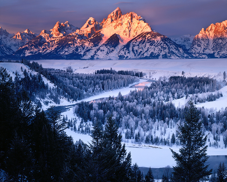 Winter sunrise light on the Teton Range viewed from the Snake River Overlook; Grand Teton National Park, WY