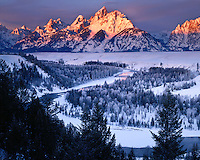 Winter sunrise light on the Teton Range viewed from the Snake River Overlook; Grand Teton National Park, WY