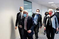 United States Senator Cory Booker (Democrat of New Jersey), left, and United States Senator Lindsey Graham (Republican of South Carolina), second from left, and other Senators evacuate to a safe place in the Dirksen Senate Office Building after Electoral votes being counted during a joint session of the United States Congress to certify the results of the 2020 presidential election in the US House of Representatives Chamber in the US Capitol in Washington, DC on Wednesday, January 6, 2021, as interrupted as thousands of pr-Trump protestors stormed the U.S. Capitol and the House chambers.  .<br /> Credit: Rod Lamkey / CNP/AdMedia