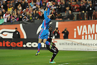 Washington D.C. - March 8, 2014: Steven Clark (1) of the Columbus Crew goes up to make a save.  The Columbus Crew defeated D.C. United 3-0 during the opening game of the 2014 season at RFK Stadium.