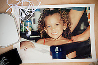 The photograph on the table in Sophie Serrano's lounge shows Manon, her daughter, when she was 4 years old with her newborn sister, Thorenc, France, 11 November 2013. Manon, born on the 4th July 1994, was accidentally switched with another baby at the maternity clinic 5 days after she was born. Manon's true identity wasn't discovered until 2004 and she, like the baby she was swapped with, has stayed with the family that raised her.