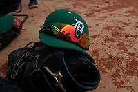 Dartmouth Big Green hat, glove, and sunglasses in the dugout during a game against the Indiana State Sycamores on February 21, 2020 at North Charlotte Regional Park in Port Charlotte, Florida.  Indiana State defeated Dartmouth 1-0.  (Mike Janes/Four Seam Images)