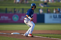 Jose Rodriguez (12) of the Kannapolis Cannon Ballers takes his lead off of third base against the Columbia Fireflies at Atrium Health Ballpark on May 20, 2021 in Kannapolis, North Carolina. (Brian Westerholt/Four Seam Images)