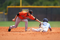 Baltimore Orioles shortstop Gunnar Henderson (93) tags Michael Berglund (19) sliding in safely during a Minor League Spring Training game against the Tampa Bay Rays on April 23, 2021 at Charlotte Sports Park in Port Charlotte, Florida.  (Mike Janes/Four Seam Images)