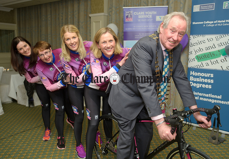 Cathaoirleach of Clare County Council James Breen gets a push from Mary Mc Ardle, co-ordinator Turas na mBan, Marissa Mc Carthy, Margaret Kenneally, chairperson Clare Ladies Cycling club,  and Jackie Darmody at the launch of Turas Na mBan, which takes place on April 23rd, hosted by the Clare Ladies Cycling Club in aid of Clare Youth Services. Photograph by John Kelly.