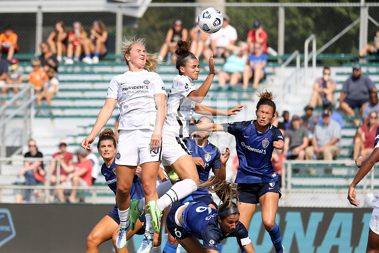 CARY, NC - SEPTEMBER 12: Sophia Smith #9 and Lindsey Horan #10 of the Portland Thorns FC challenge for a header with Carson Pickett #4 and Abby Erceg #6 of the North Carolina Courage during a game between Portland Thorns FC and North Carolina Courage at Sahlen's Stadium at WakeMed Soccer Park on September 12, 2021 in Cary, North Carolina.