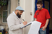 Ziaur Rahman, Community Development Officer, Queens Park, does a door-to-door housing conditions survey in Bravington Road.  The area contains housing association, council and owner-occupied properties.