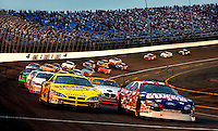 Winston Cup drivers exit turn 4 at Lowe?s Motor Speedway during the running of the Winston Open.