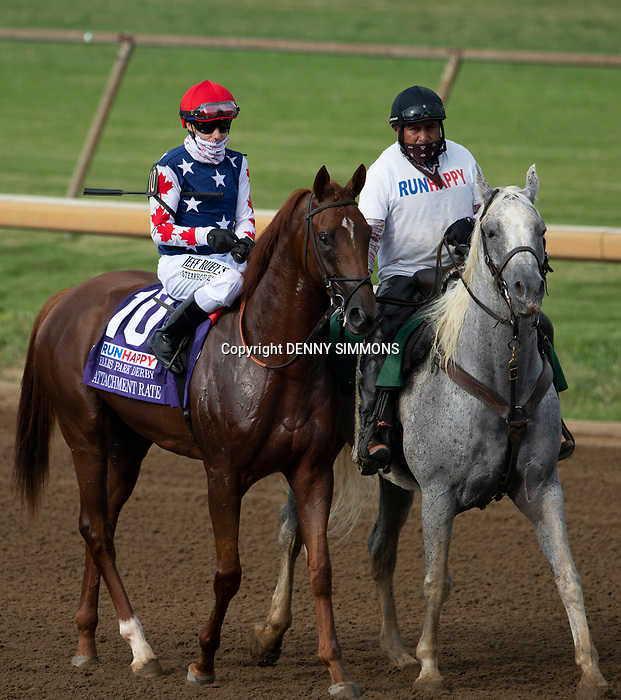 Attachment Rate, ridden by Joseph Talamo, is led from the paddock before the Runhappy Ellis Park Derby's 10th race for a $200,000 purse at Ellis Park in Henderson, Ky., Sunday afternoon, Aug. 9, 2020. Art Collector won the race by 3 1/4 lengths and Attachment Rate finished second. The race is a qualifier for the upcoming Sept. 5, 2020, Kentucky Derby, with 85 points (50-20-10-5) up for grabs.