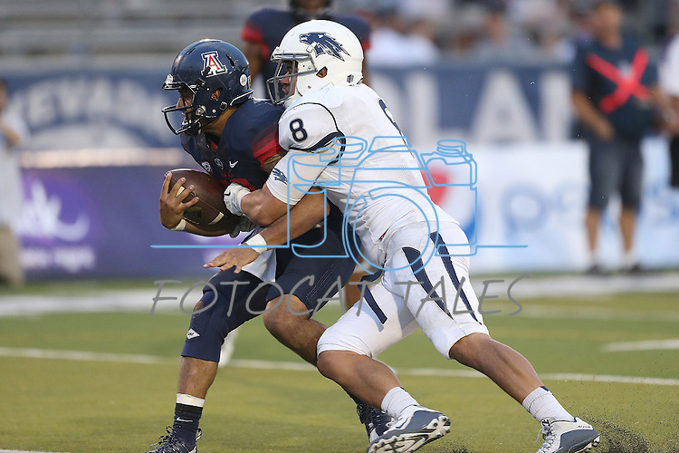 Nevada's Ian Seau (8) sacks Arizona quarterback Anu Solomon (12) in the second half of an NCAA college football game in Reno, Nev., on Saturday, Sept. 12, 2015. Arizona defeated Nevada 44-20. (AP Photo/Cathleen Allison)