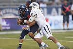 Nevada's Ian Seau (8) sacks Arizona quarterback Anu Solomon (12) in the second half of an NCAA college football game in Reno, Nev., on Saturday, Sept. 12, 2015. Arizona defeated Nevada 44-20. (AP Photo/Cathleen Allison)
