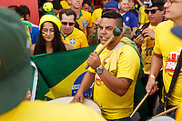 Brazil fans sing and drum outside the stadium before kick off