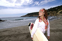 woman with surfboard in Ibiza, Spain