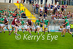 Kevin Goulding of Ballyduff hand passes the sliotar as  Causeway's Anthony Fealy bares down on him in round 2 of the County Senior Hurling championship,