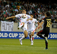 Costa Rica's Jhonny Acosta clears the ball in front of Mexico's Andres Guardado.  Mexico defeated Costa Rica 4-1 at the 2011 CONCACAF Gold Cup at Soldier Field in Chicago, IL on June 12, 2011.