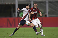 Roberto Soriano of Bologna FC and Ante Rebic of AC Milan compete for the ball during the Serie A football match between AC Milan and Bologna FC at stadio Giuseppe Meazza in Milano ( Italy ), July 18th, 2020. Play resumes behind closed doors following the outbreak of the coronavirus disease. <br /> Photo Image Sport / Insidefoto