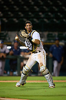 Bradenton Marauders catcher Endy Rodriguez (5) throws to first base during Game One of the Low-A Southeast Championship Series against the Tampa Tarpons on September 21, 2021 at LECOM Park in Bradenton, Florida.  (Mike Janes/Four Seam Images)