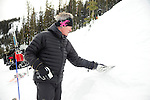 Crested Butte ski patrol  director Frank Coffee inspects snow crystals to help gauge the stability of the snowpack, and assess the avalanche risk.