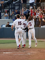 Jacob Berry (15) is greeted at home plate by Branden Bossiere (17) and Donta Williams (23) of the Arizona Wildcats after hitting a third inning home run in the Wildcats 16-3 victory over the Ole Miss Rebels in the final game of the NCAA Super Regional at Hi Corbett Field on June 13, 2021 in Tucson, Arizona. Arizona qualifies for the College World Series with the victory. (Bill Mitchell)