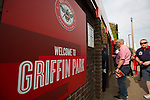 Home supporters entering the stadium at the turnstiles on Braemar Road before Brentford hosted Leeds United in an EFL Championship match at Griffin Park. Formed in 1889, Brentford have played their home games at Griffin Park since 1904, but are moving to a new purpose-built stadium nearby. The home team won this match by 2-0 watched by a crowd of 11,580.