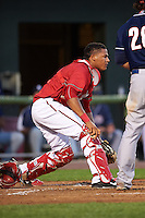 Harrisburg Senators catcher Pedro Severino (4) checks the runner after blocking a pitch in the dirt during a game against the New Hampshire Fisher Cats on July 21, 2015 at Metro Bank Park in Harrisburg, Pennsylvania.  New Hampshire defeated Harrisburg 7-1.  (Mike Janes/Four Seam Images)