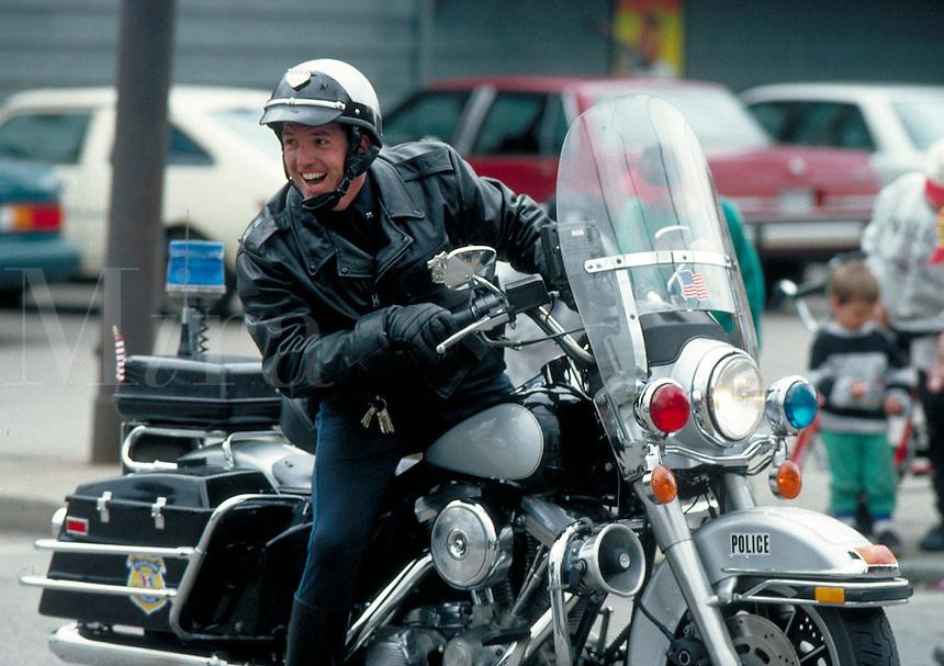 A motorcycle policeman giving a big smile. Motorcycle Policeman. Cleveland Ohio USA.