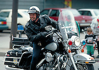 A motorcycle policeman giving a big smile. Motorcycle Policeman. Cleveland Ohio USA.