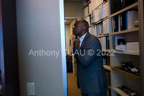 Houston, Texas<br /> October 2, 2011<br /> <br /> Tying his tie, in his office, general manager and first as executive vice president, Rick Smith oversees all aspects of football operations. Smith has strengthened Houston's roster through the draft, free agency and several trades at key positions.<br /> <br /> The Houston Texans defeated the Pittsburgh Steelers at the Reliant Stadium 17 to 10.