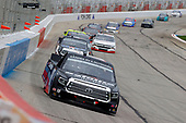 HAMPTON, GEORGIA - JUNE 06: Christian Eckes, driver of the #18 Safelite AutoGlass Toyota, leads a pack of trucks during the NASCAR Gander Outdoors Truck Series Vet Tix Camping World 200 at Atlanta Motor Speedway on June 06, 2020 in Hampton, Georgia. (Photo by Kevin C. Cox/Getty Images)