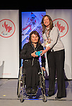 Calgary, AB - June 5 2014 - Collette Bourgonje receives her Paralympic ring from Erin Kelly, of Suncor/Petro-Canada, during the Celebration of Excellence Paralympic Ring Reception in Calgary. (Photo: Matthew Murnaghan/Canadian Paralympic Committee)