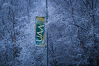 UAA signage along Providence Drive after a snowfall.