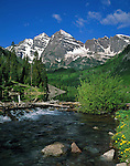 The Maroon Bells Peaks and Maroon Creek in Maroon Bells-Snowmass Wilderness Area, Aspen, Colorado, USA, .  John offers private wildflower tours in the Crested Butte area and throughout Colorado. Year-round. .  John leads private photo tours throughout Colorado. Year-round Colorado photo tours.