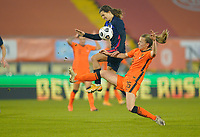 BREDA, NETHERLANDS - NOVEMBER 27: Tobin Heath #17 of the United States defends against approaching Dominique Janssen #15 of the Netherlands during a game between Netherlands and USWNT at Rat Verlegh Stadion on November 27, 2020 in Breda, Netherlands.