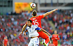 EURO 2016 QUALIFYING: WALES V ISRAEL AT CARDIFF CITY STADIUM : <br /> Orel Dgani of Israel challenges Sam Vokes of Wales for the high ball in the second half.<br /> <br /> EDITORIAL USE ONLY.