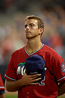 """Fort Myers Miracle pitcher Bryan Sammons (32) stands for """"God Bless America"""" during the seventh inning stretch of a Florida State League game against the Charlotte Stone Crabs on April 6, 2019 at Charlotte Sports Park in Port Charlotte, Florida.  Fort Myers defeated Charlotte 7-4.  (Mike Janes/Four Seam Images)"""