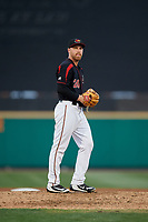 Rochester Red Wings relief pitcher Dietrich Enns (20) gets ready to deliver a pitch during a game against the Lehigh Valley IronPigs on September 1, 2018 at Frontier Field in Rochester, New York.  Lehigh Valley defeated Rochester 2-1.  (Mike Janes/Four Seam Images)