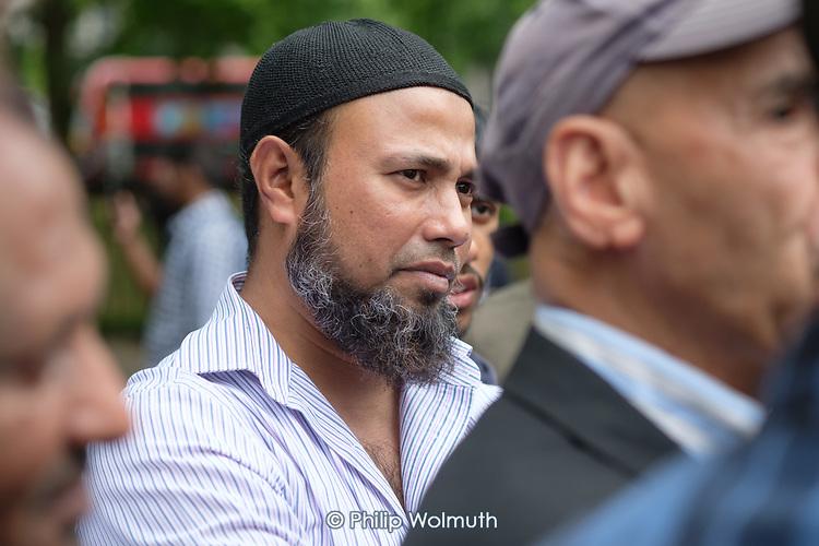 Onlooker in religious debate, Speakers' Corner, Hyde Park, London.